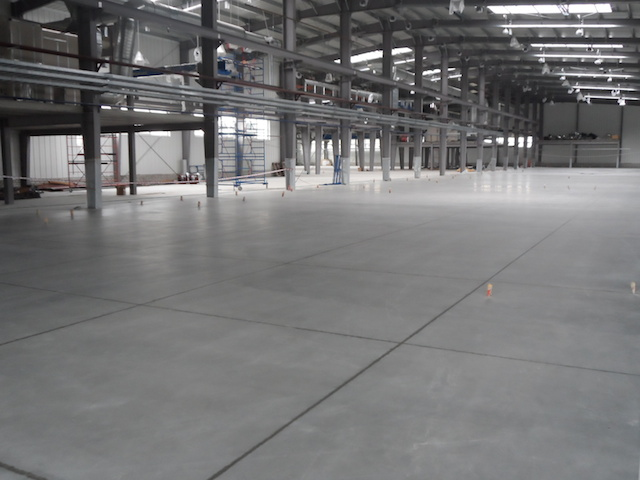 Sleek floors polished concrete project in warehouse for What to clean concrete floors with